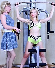 Elegant sissy lady begs a strapon-armed sporty blonde for a fuck in the gym