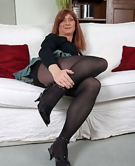 Lucimay slips down her opaque pantyhose and grabs hard of that big dick of hers.
