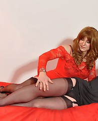 Two sexy crossdressers have a little bit of rope play before the blowjobs start.