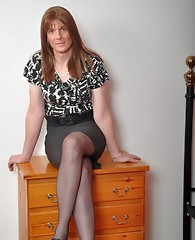 One seriously cute TGirl posing in her short skirt and nylon stockings.