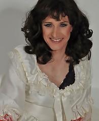 Sexy crossdresser wearing a long wedding dress and horny satin gloves.