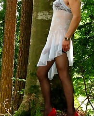 Naughty crossdresser showing off his nylons and cock outdoors