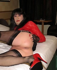 Slutty Yvette is dressed in some gorgeous red lace