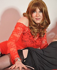 Gorgeous crossdresser in red rope ties cute TGirl to the bed, then sucks her cock